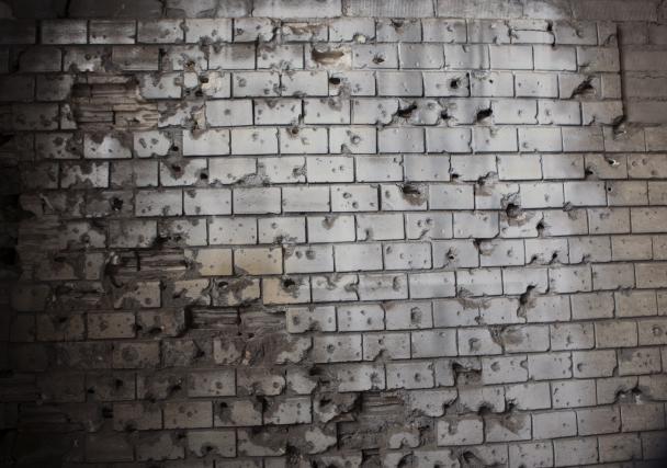 KULEHULL. Under andre verdenskrig fant skuddvekslinger sted i toppen av bygningen. De øverste etasjene er i dag delvis rekonstruert etter bombenedslag.
