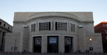 13 October 2012, 20th Anniversary banners hang on the 14th street entrance to the United States Holocaust Memorial Museum